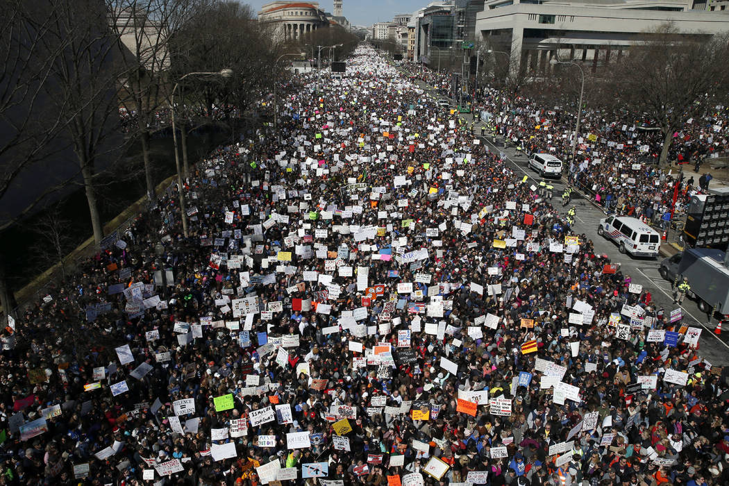 "Looking west, people fill Pennsylvania Avenue during the ""March for Our Lives"" rally in support of gun control, Saturday, March 24, 2018, in Washington. (AP Photo/Alex Brandon)"