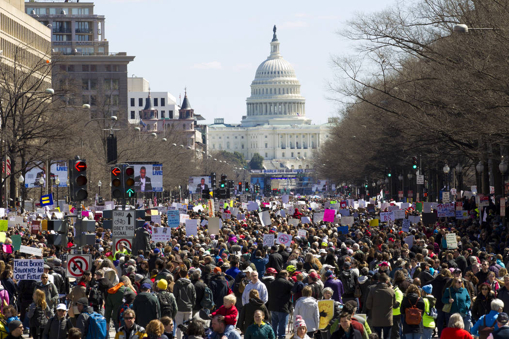 "Protesters stand Pennsylvania Avenue looking east toward the stage located near the Capitol during the ""March for Our Lives"" rally in support of gun control in Washington, Saturday, Marc ..."