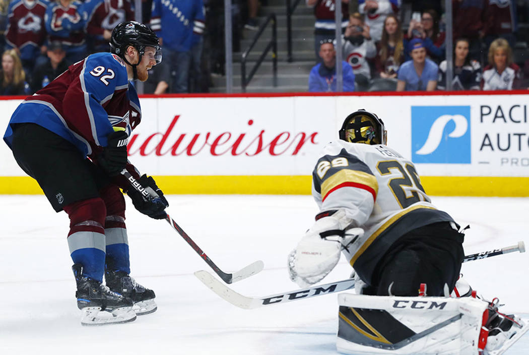 Colorado Avalanche left wing Gabriel Landeskog, left, scores the winning goal past Vegas Golden Knights goaltender Marc-Andre Fleury in the shootout session of an NHL hockey game Saturday, March 2 ...