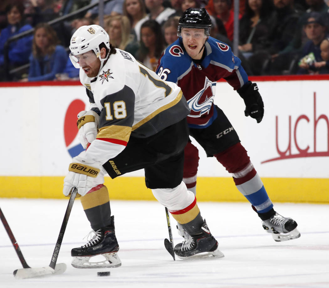 Vegas Golden Knights left wing James Neal, front, loses control of the puck as Colorado Avalanche right wing Mikko Rantanen defends in the first period of an NHL hockey game Saturday, March 24, 20 ...