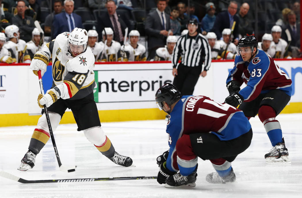 Vegas Golden Knights left wing James Neal, left, unleashes a shot as Colorado Avalanche left wing Blake Comeau, front right, and left wing Matt Nieto defend in the second period of an NHL hockey g ...