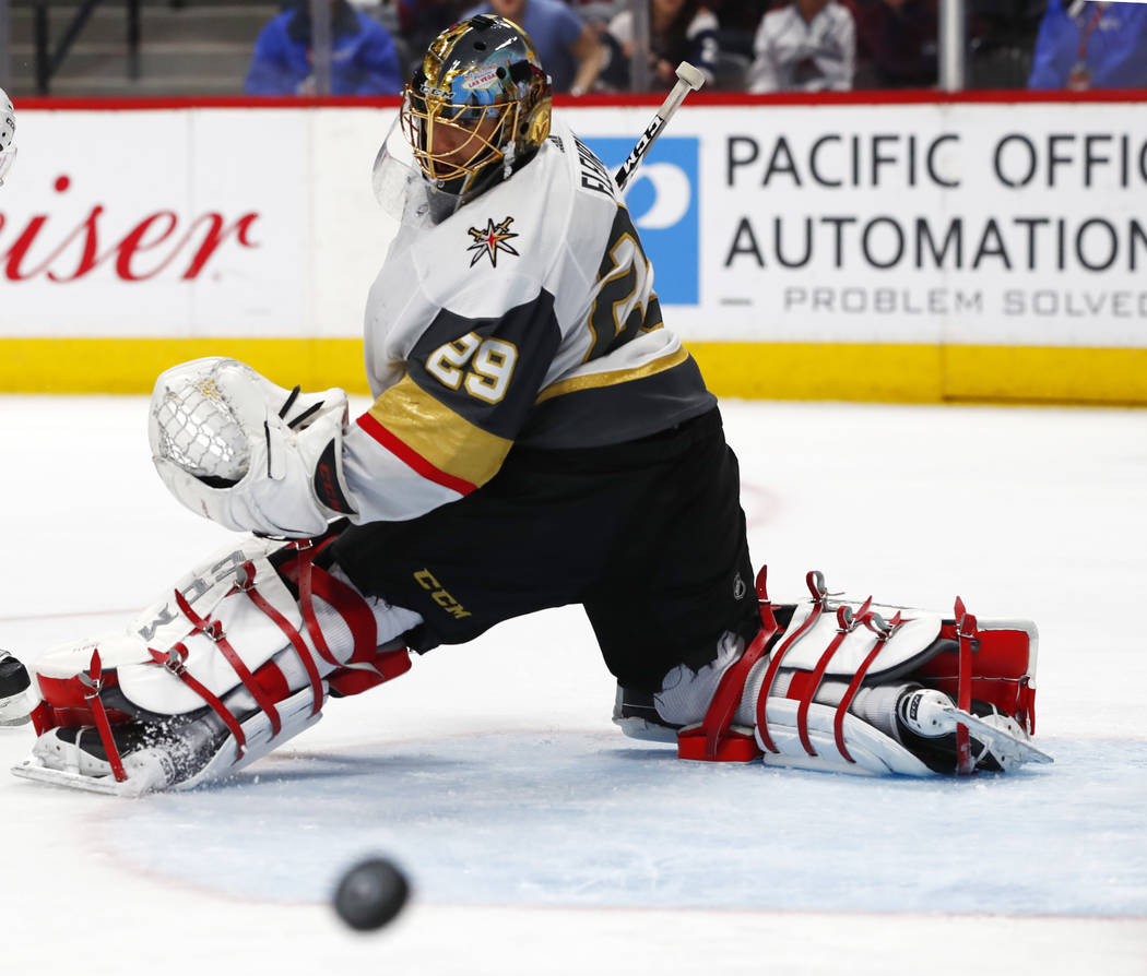 Vegas Golden Knights goaltender Marc-Andre Fleury follows the flight of the puck after deflecting a shot against the Colorado Avalanche in the third period of an NHL hockey game Saturday, March 24 ...