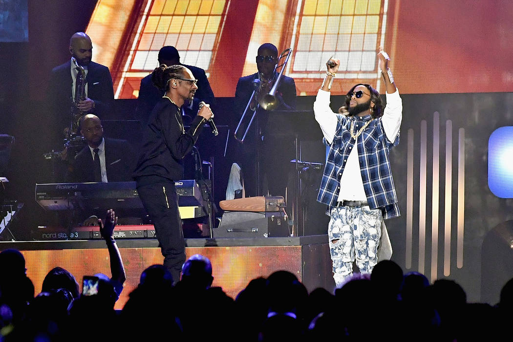 LAS VEGAS, NV - MARCH 24:  Snoop Dogg (L) and B.Slade perform during the 33rd annual Stellar Gospel Music Awards at the Orleans Arena on March 24, 2018 in Las Vegas, Nevada.  (Photo by Earl Gibson ...