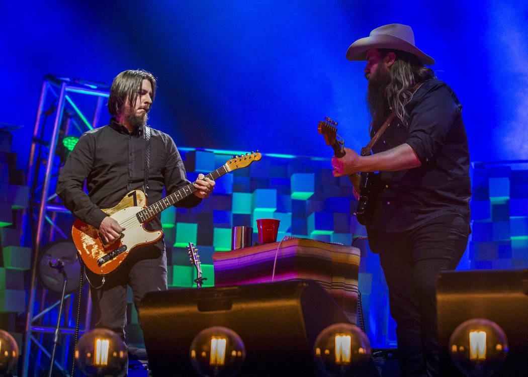 Country musician Chris Stapleton shares a moment with his guitarist at the MGM Grand Garden Arena in Las Vegas on Friday, March 23, 2018.  Patrick Connolly Las Vegas Review-Journal @PConnPie