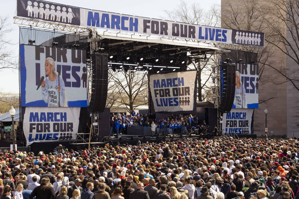 "Ariana Grande performs at the ""March for Our Lives"" rally in support of gun control in Washington, Saturday, March 24, 2018, on Pennsylvania Avenue near the U.S. Capitol. (AP Photo/Cliff ..."