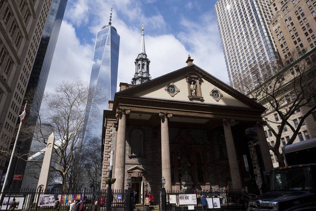 One World Trade Center towers above St. Paul's Chapel in New York, March 16, 2018. (AP Photo/Mark Lennihan)