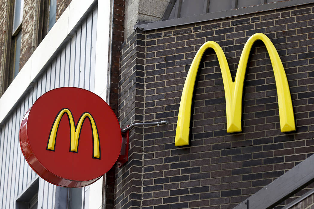 Corporate signage hangs at a McDonald's restaurant in downtown Pittsburgh, April 24, 2017. (AP Photo/Keith Srakocic, File)