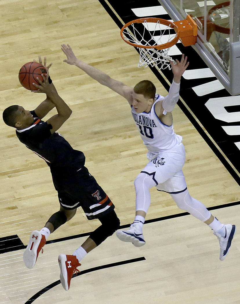 Texas Tech's Jarrett Culver, left, shoots against Villanova's Donte DiVincenzo,right, during the second half of an NCAA men's college basketball tournament regional final, Sunday, March 25, 2018,  ...