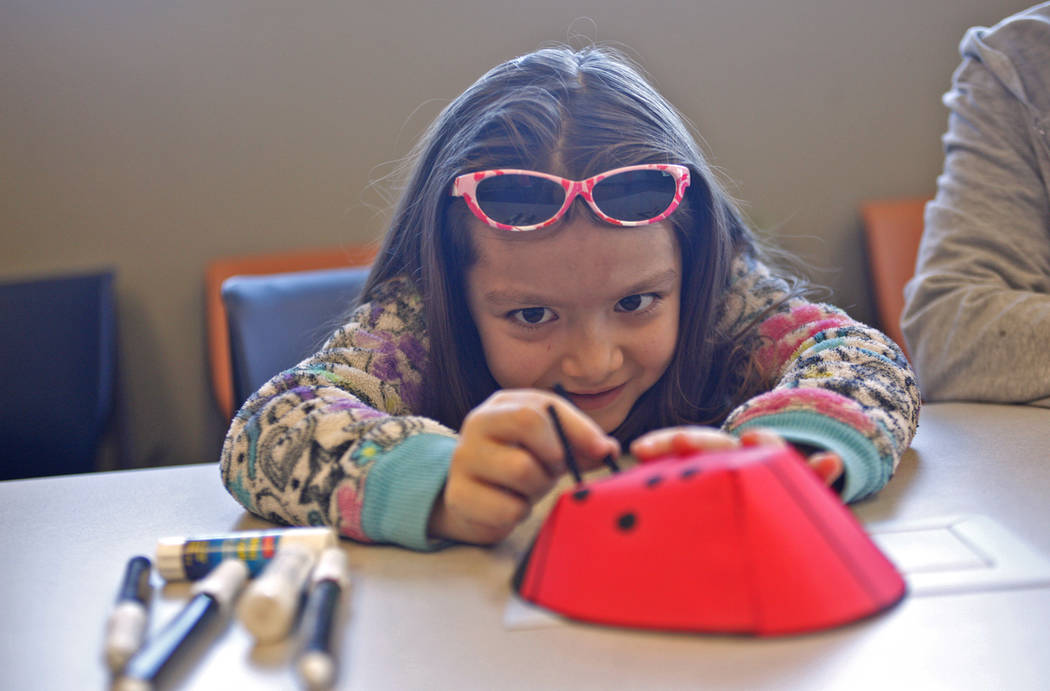 Sophia Barnes, 6, adds an antenna to her ladybug as part of the Young Explorers program at the Clark County Wetlands Park in Las Vegas, Sunday, March 25, 2018. (Rachel Aston Las Vegas Review-Journ ...