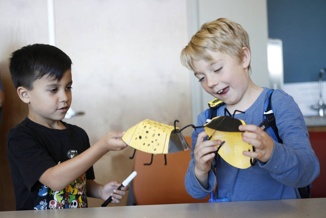 Jesse Camacho, 6, left, and Bodhi Brouillet, 7, play with their paper ladybugs as part of the Young Explorers program at the Clark County Wetlands Park in Las Vegas, Sunday, March 25, 2018. (Rache ...