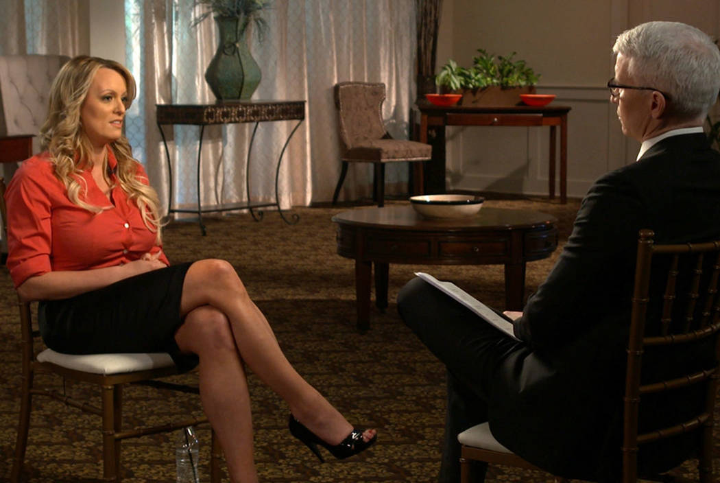"""Stormy Daniels, left, is interviewed by Anderson Cooper for """"60 Minutes."""" (CBS News/60 Minutes via AP)"""