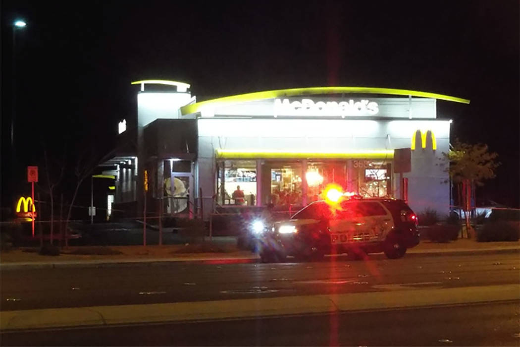 Police investigate a shooting in the McDonald's parking lot at 3885 Blue Diamond Road in Las Vegas on Sunday. (Max Michor/Las Vegas Review-Journal)