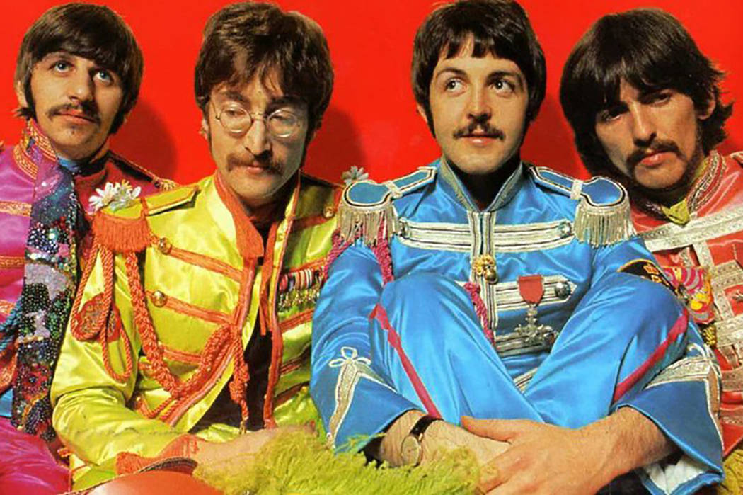 "The centerfold of the 1967 Beatles album ""Sgt. Pepper's Lonely Hearts Club Band"" features the Fab Four in costume as an Edwardian-era military band. Ringo Starr, left. John Lennon, Paul McCartney  ..."