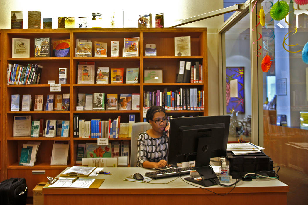 Program Manager Jasmine Sligh answers the phone at the Lynne Ruffin-Smith Library at the Cleveland Clinic in Las Vegas, Monday, March 26, 2018. The library provides resources about Alzheimer's dis ...