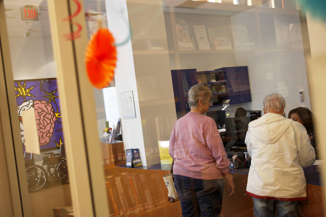 Visitors speaks to the receptionist at the lobby at the Cleveland Clinic in Las Vegas, Monday, March 26, 2018. A new study released Tuesday by the Alzheimer's Association reports that Nevada will  ...