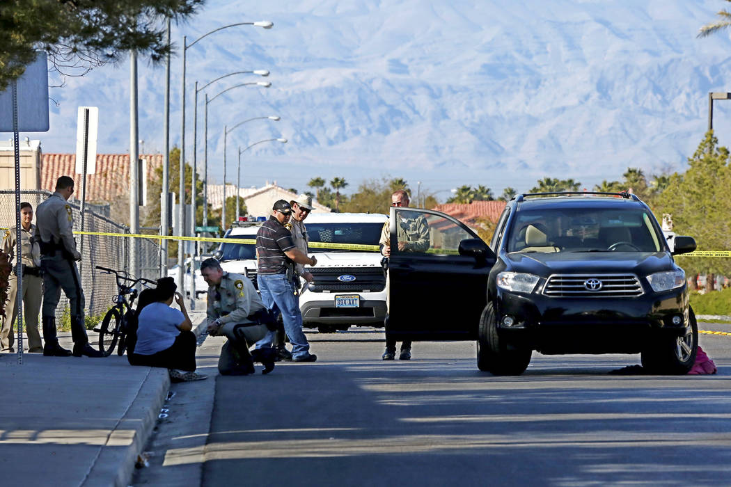 Police investigate the scene of a fatal crash near Jack Leavitt Street and Riverdance Avenue in Las Vegas on Friday, March 23, 2018. (Andrea Cornejo/Las Vegas Review-Journal) @dreacornejo