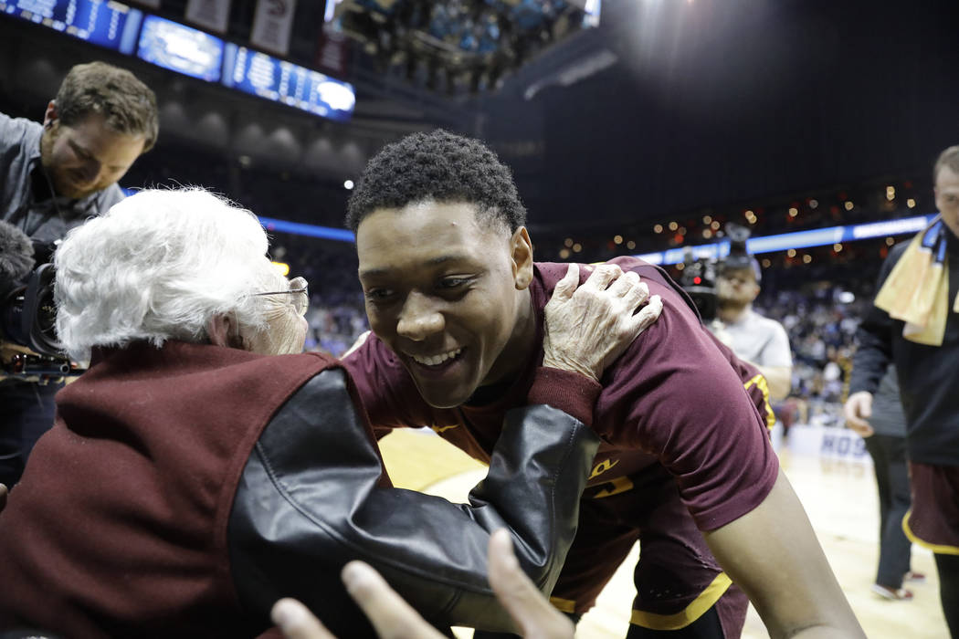 Sister Jean Dolores Schmidt embraces Loyola-Chicago guard Cameron Satterwhite after a regional semifinal NCAA college basketball game against Nevada, Thursday, March 22, 2018, in Atlanta. Loyola-C ...