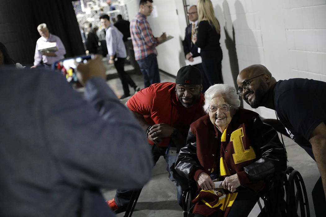Loyola-Chicago basketball chaplain Sister Jean Dolores Schmidt, poses with fans for a photo before the first half of a regional final NCAA college basketball tournament game, Saturday, March 24, 2 ...