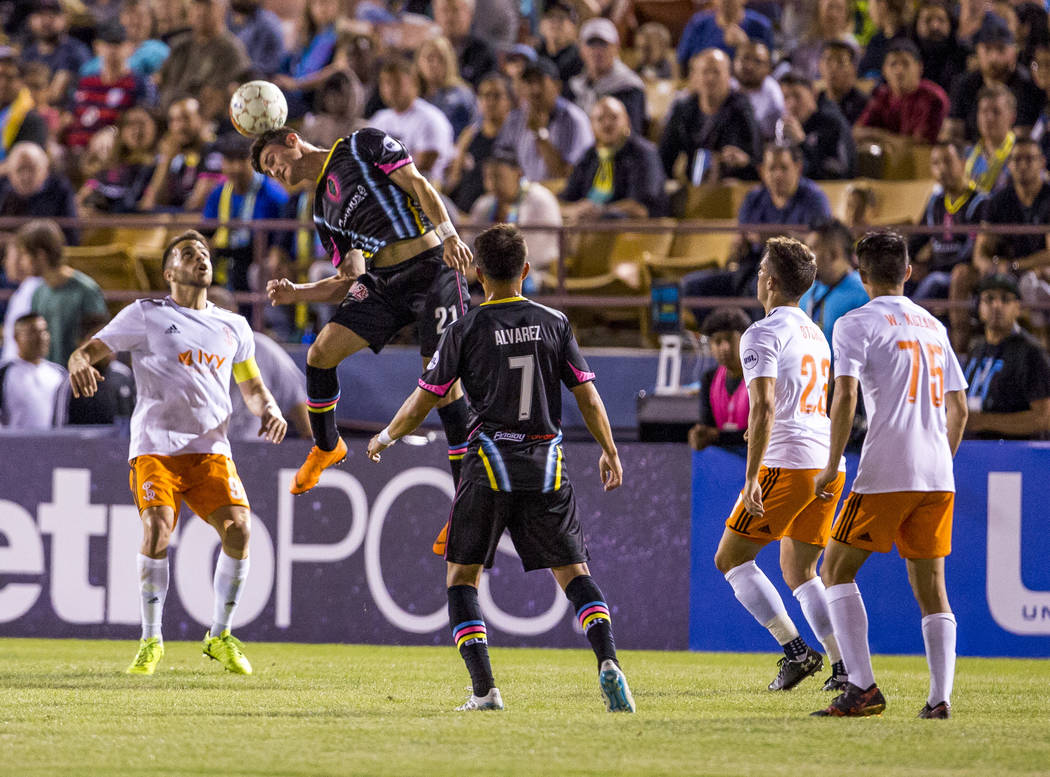 Lights forward Matt Thomas head butts a ball during the first half of a game against the Swope Park Rangers at Cashman Field in Las Vegas on Saturday, March 31, 2018.  Patrick Connolly Las Vegas R ...