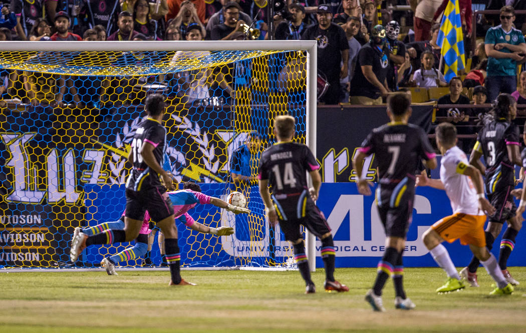 Las Vegas Lights goalie Ricardo Ferrino misses a shot by Swope Park midfielder Rodrigo Saravia during the first half of a game against the Swope Park Rangers at Cashman Field in Las Vegas on Satur ...