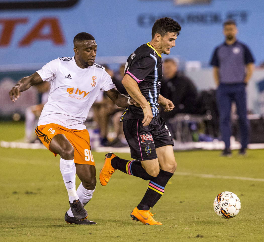 Lights forward Matt Thomas tries to take the ball away from Swope Park forward Kharlton Belmar during the second half of a United Soccer League game at Cashman Field in Las Vegas on Saturday, Marc ...