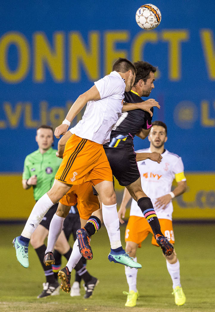 Lights forward Juan Carlos Garcia and Swope Park defender Graham Smith both go up for a header during the second half of a United Soccer League game at Cashman Field in Las Vegas on Saturday, Marc ...