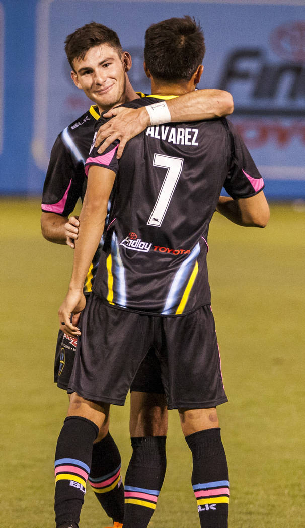 Lights forward Matt Thomas hugs forward Carlos Alvarez after Alvarez scored during the second half of a United Soccer League game at Cashman Field in Las Vegas on Saturday, March 31, 2018. The Lig ...