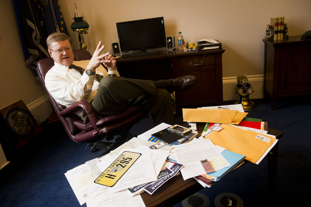 In his Capitol Hill office on Tuesday, Rep. Mark Amodei, R-Nev., displays the lapel pin, license plate and other items given to members of Congress before a new session. (Lisa Helfert/Stephens Media)