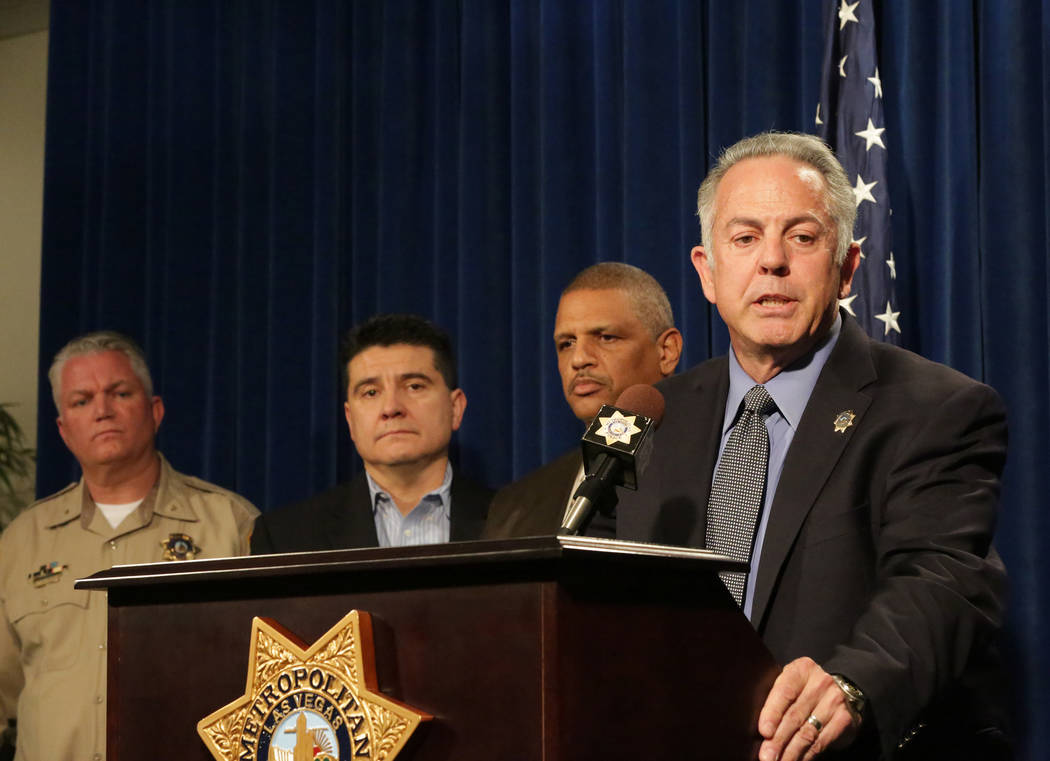 During a press conference at Las Vegas Metropolitan Police Department Headquarters on Monday, March 25, 2018, Sheriff Joe Lombardo, right, stands with Deputy Chief Christopher Darcy, left, Lieuten ...