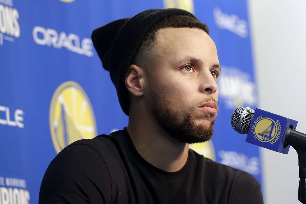 Golden State Warriors guard Stephen Curry speaks at a news conference before an NBA basketball game between the Warriors and the Utah Jazz in Oakland, Calif., Sunday, March 25, 2018. (AP Photo/Jef ...