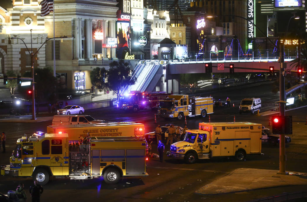 Las Vegas police and emergency vehicles on scene following an active shooter situation that left 58 dead and over 500 injured on the Las Vegas Strip during the early hours of Monday, Oct. 2, 2017. ...
