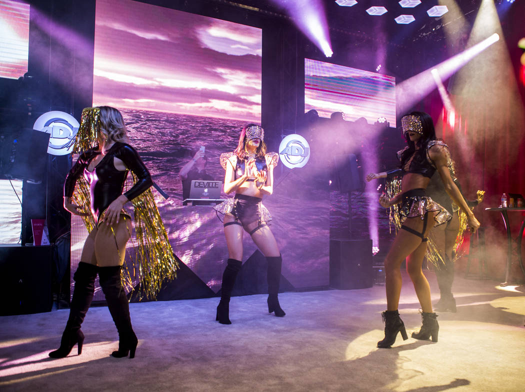 Dancers perform at a booth for ADJ lighting equipment during the Nightclub and Bar Show at the Las Vegas Convention Center on Tuesday, March 27, 2018.  Patrick Connolly Las Vegas Review-Journal @P ...