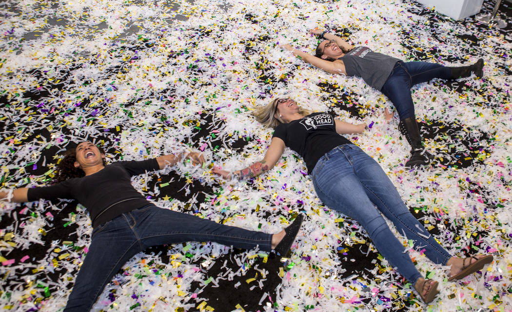 Colton, Calif, residents, from left, Yara Harris, Ericka Dare and Yaci Perry enjoy confetti during the Nightclub and Bar Show at the Las Vegas Convention Center on Tuesday, March 27, 2018.  Patric ...