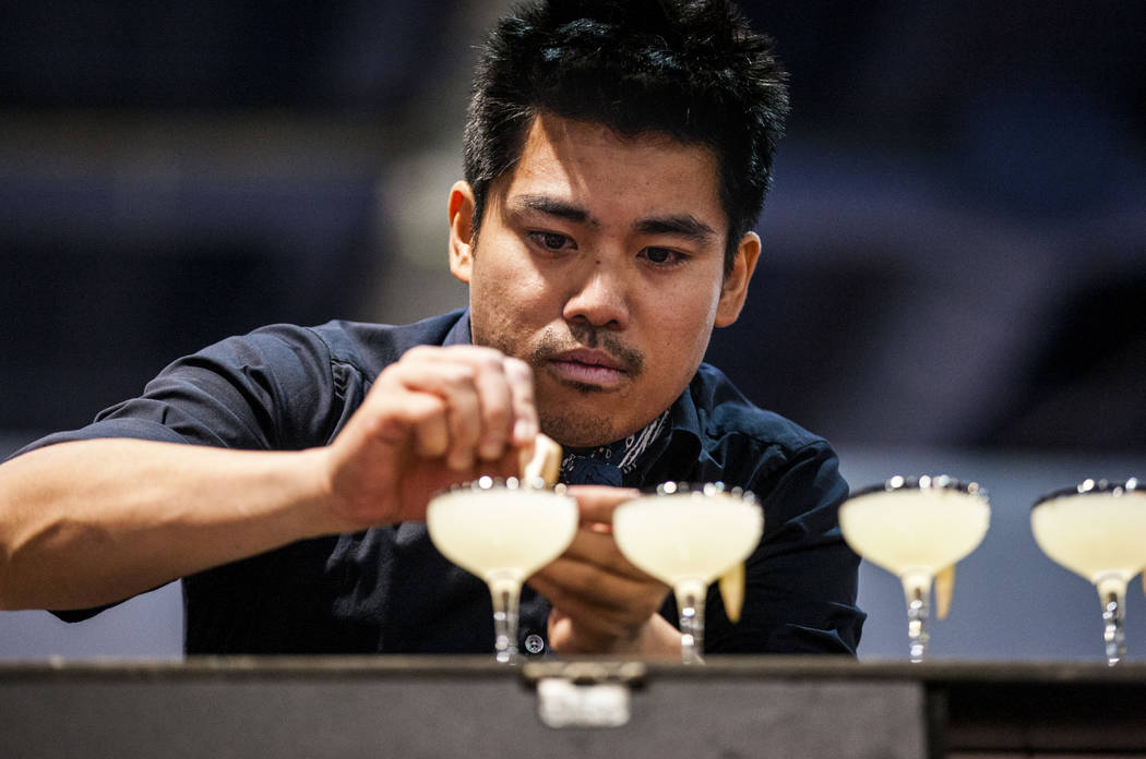 Ram Ong adds lemon slices to a drink for a bartender competition during the Nightclub and Bar Show at the Las Vegas Convention Center on Tuesday, March 27, 2018.  Patrick Connolly Las Vegas Review ...