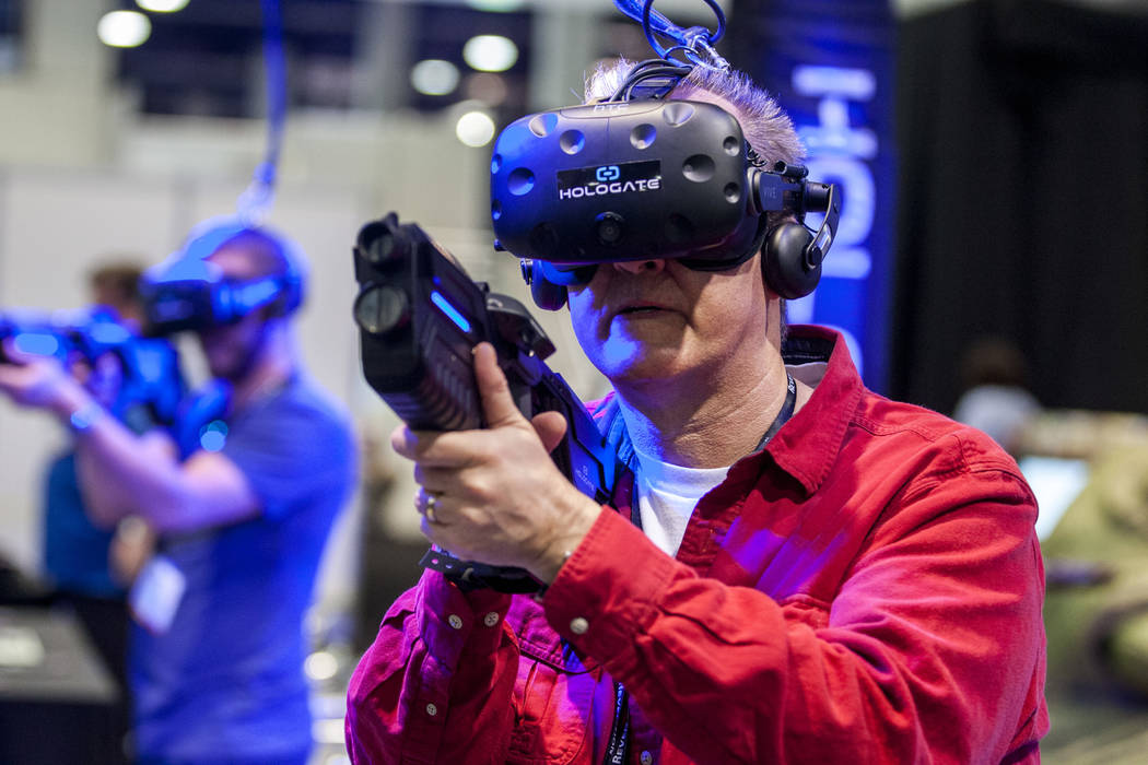 Charles Womack, publisher of Yes! Weekly magazine in Greensboro, N.C., tries out a virtual reality game from Hologate during the Nightclub and Bar Show at the Las Vegas Convention Center on Tuesda ...
