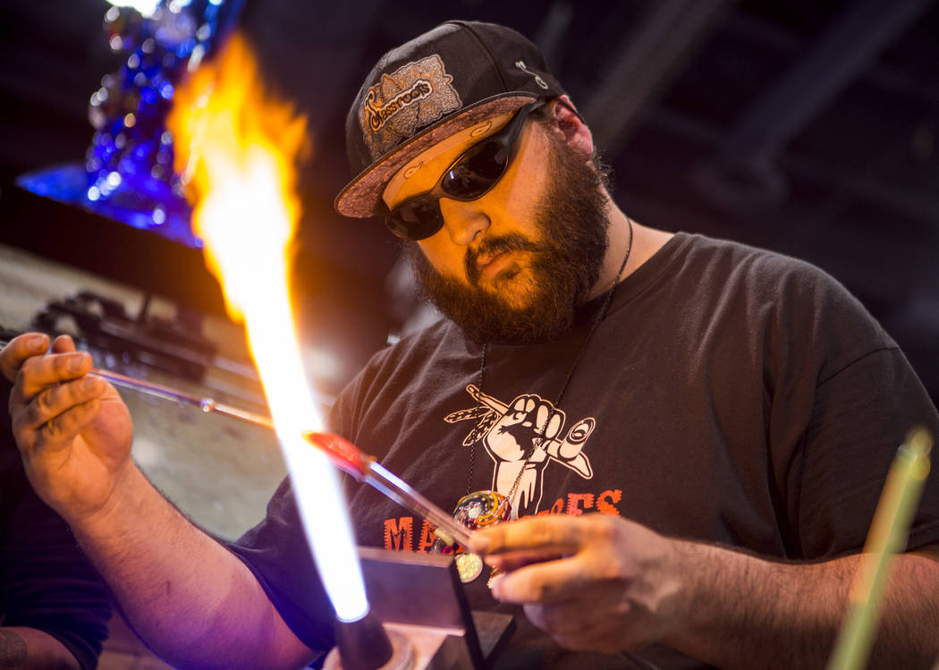 The owner of Glass by Who demonstrates his glass work during the Nightclub and Bar Show at the Las Vegas Convention Center on Tuesday, March 27, 2018.  Patrick Connolly Las Vegas Review-Journal @P ...