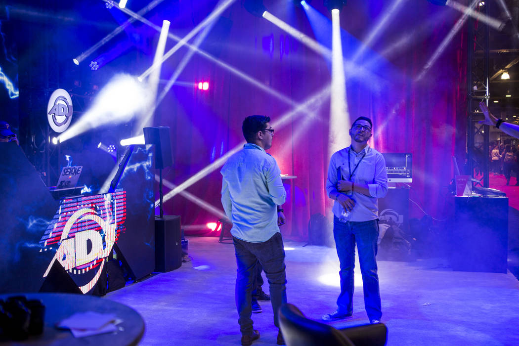 Attendees check out a booth from ADJ lighting equipment during the Nightclub and Bar Show at the Las Vegas Convention Center on Tuesday, March 27, 2018.  Patrick Connolly Las Vegas Review-Journal  ...