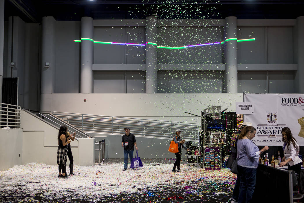 Attendees stand under falling confetti from Flutter Fetti during the Nightclub and Bar Show at the Las Vegas Convention Center on Tuesday, March 27, 2018.  Patrick Connolly Las Vegas Review-Journa ...