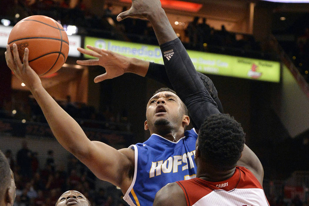 In this Nov. 12, 2013, file photo, Hofstra's Zeke Upshaw attempts a shot over the defense of Louisville's Montrezl Harrell (24) during the first half of an NCAA college basketball game, in Louisvi ...
