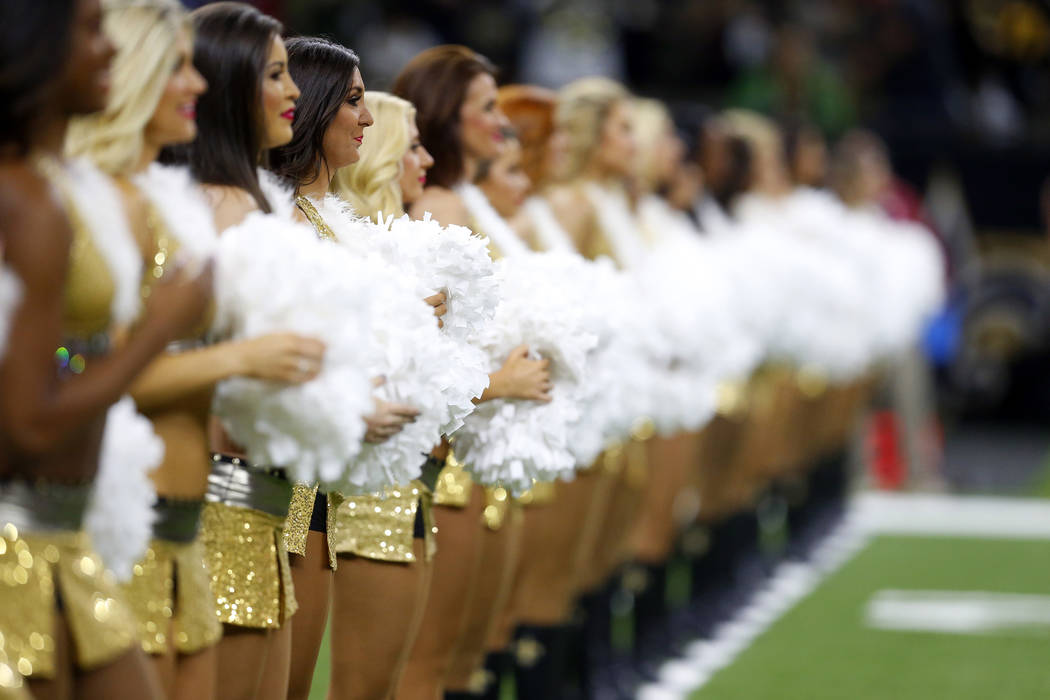 New Orleans Saints cheerleaders perform in the first half of an NFL football game against the Atlanta Falcons in New Orleans, Sunday, Dec. 24, 2017. (AP Photo/Butch Dill)