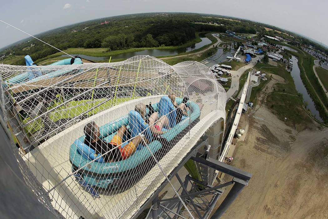 "Riders go down the water slide called ""Verruckt"" at Schlitterbahn Waterpark in Kansas City, Kan., in this file photo. (AP Photo/Charlie Riedel, File)"