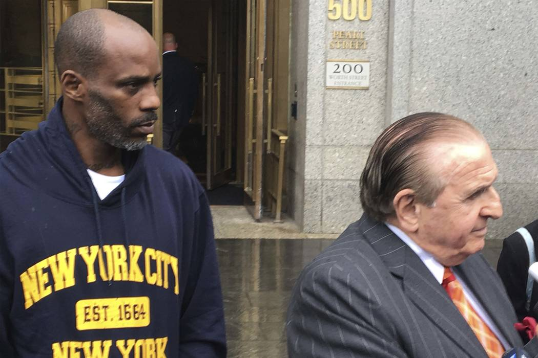 Rapper DMX, left, leaves federal court in New York with his attorney Murray Richman after pleading not guilty to tax evasion.  (AP Photo/Tom Hays, File)