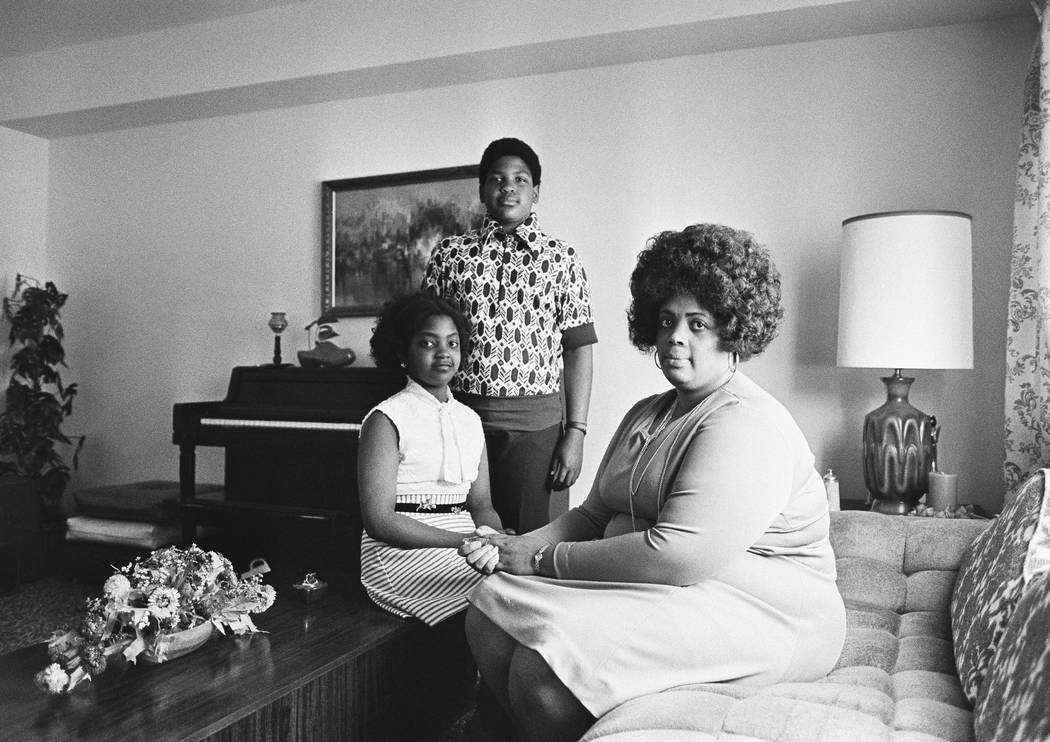 In this April 30, 1974, file photo, Linda Brown, right, and her two children pose for a photo in their home in Topeka, Kan. Brown, the Kansas girl at the center of the 1954 U.S. Supreme Court ruli ...