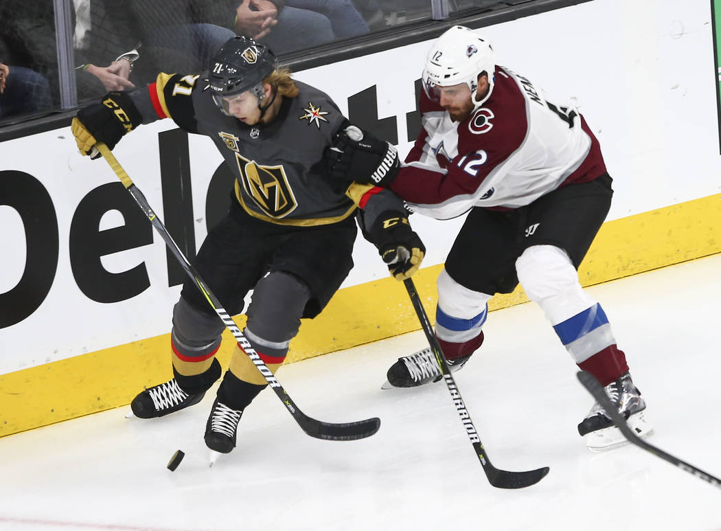 Golden Knights center William Karlsson (71) controls the puck as Colorado Avalanche defenseman Patrik Nemeth (12) defends during the first period of an NHL hockey game at T-Mobile Arena in Las Veg ...
