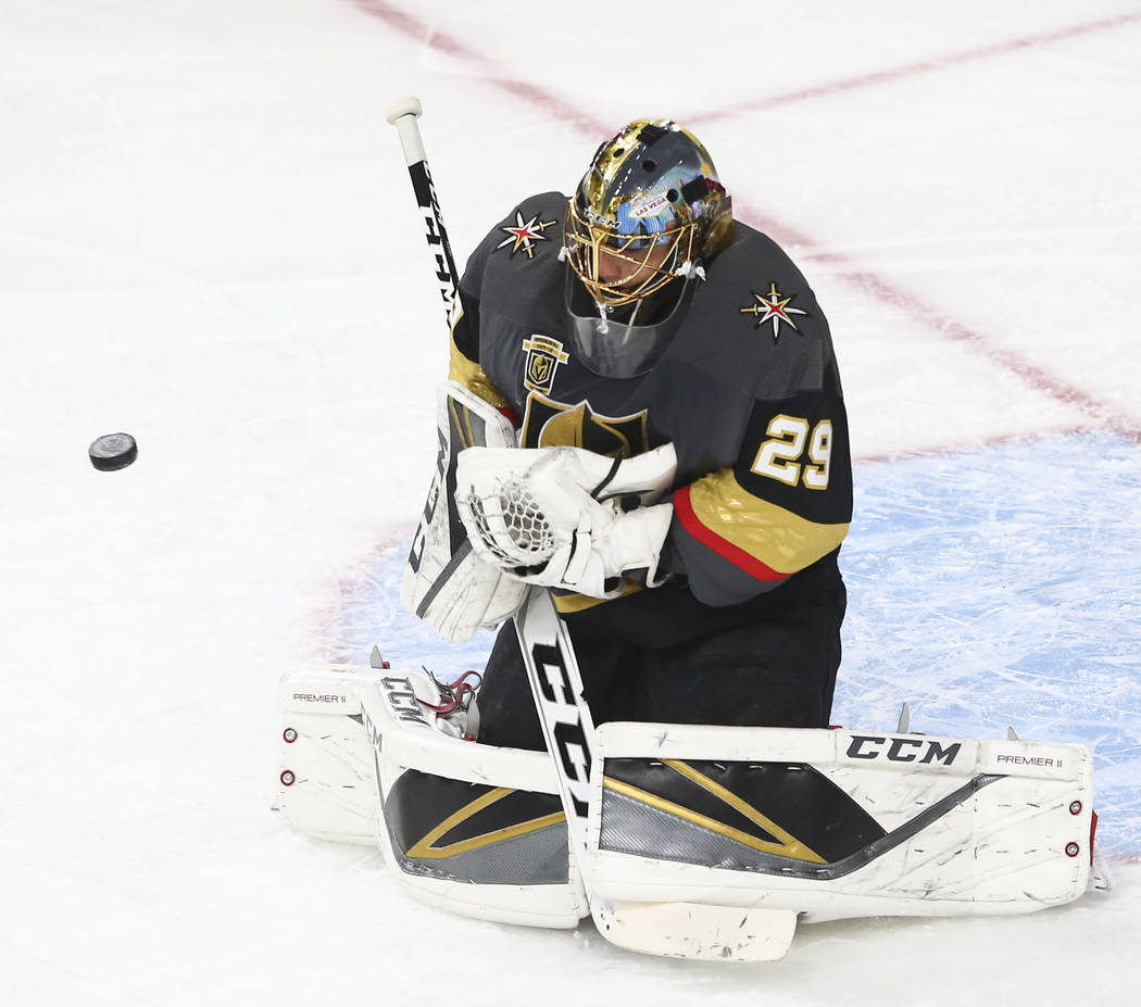 Golden Knights goaltender Marc-Andre Fleury (29) blocks a shot from the Colorado Avalanche during the first period of an NHL hockey game at T-Mobile Arena in Las Vegas on Monday, March 26, 2018. C ...