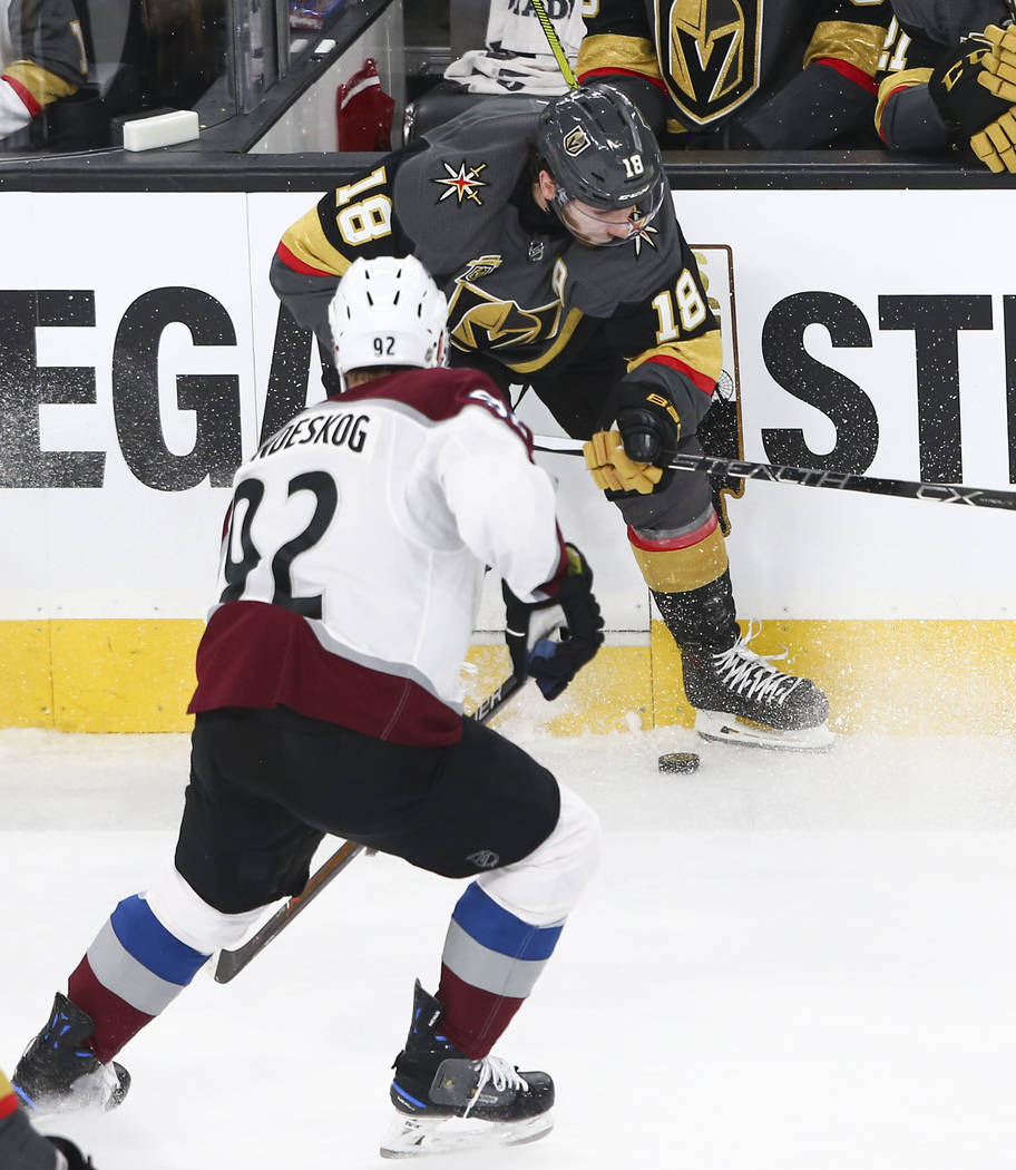 Golden Knights left wing James Neal (18) controls the puck as Colorado Avalanche left wing Gabriel Landeskog (92) defends during the first period of an NHL hockey game at T-Mobile Arena in Las Veg ...