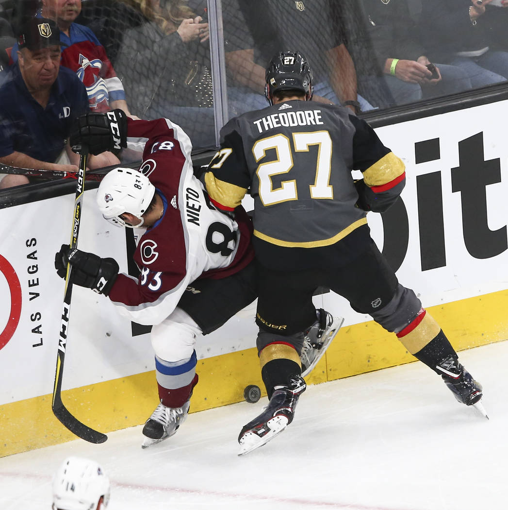 Golden Knights defenseman Shea Theodore (27) fights for the puck against Colorado Avalanche left wing Matt Nieto (83) during the second period of an NHL hockey game at T-Mobile Arena in Las Vegas  ...