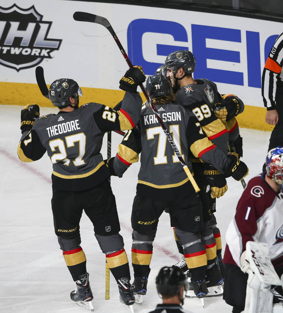 Golden Knights players celebrate a goal by right wing Alex Tuch (89) against the Colorado Avalanche during the second period of an NHL hockey game at T-Mobile Arena in Las Vegas on Monday, March 2 ...