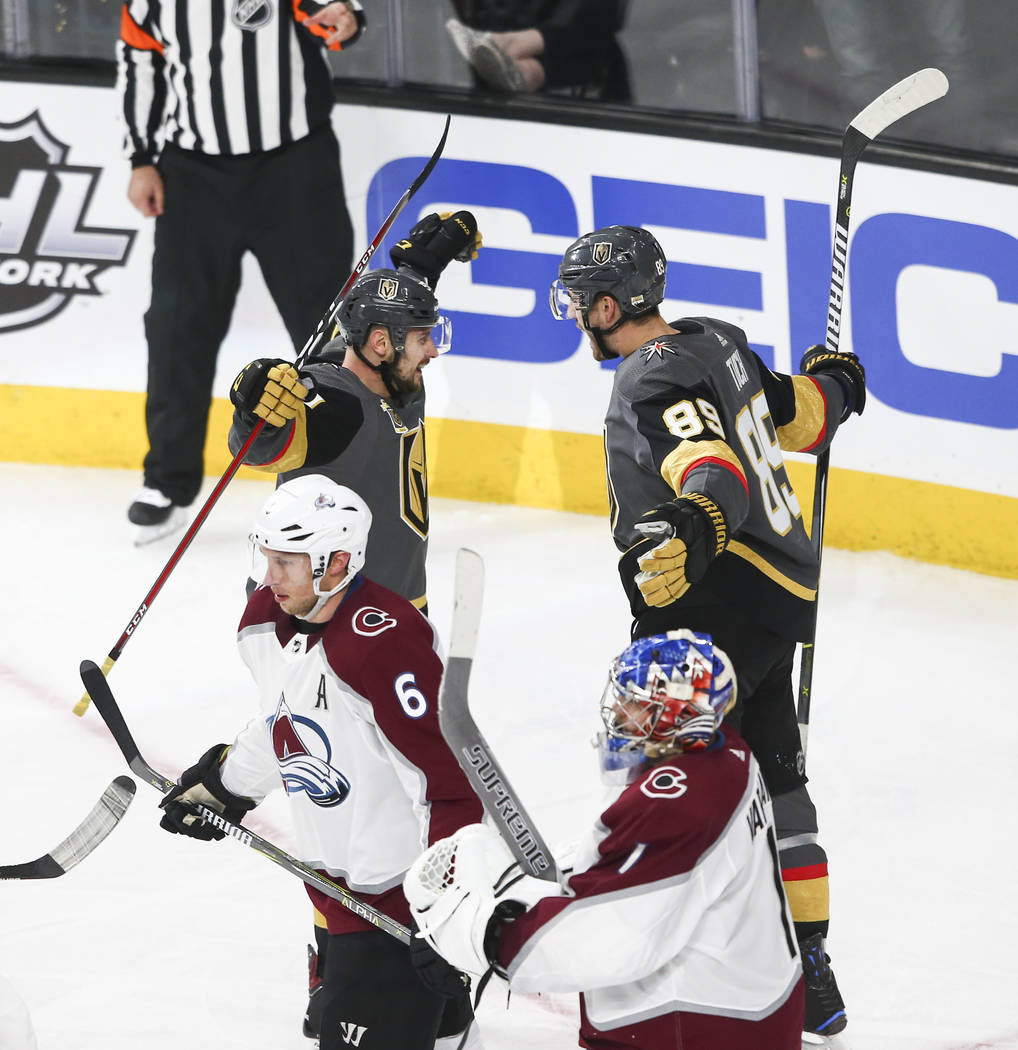 Golden Knights left wing Tomas Tatar (90) celebrates a goal by Golden Knights right wing Alex Tuch (89) during the second period of an NHL hockey game against the Colorado Avalanche at T-Mobile Ar ...