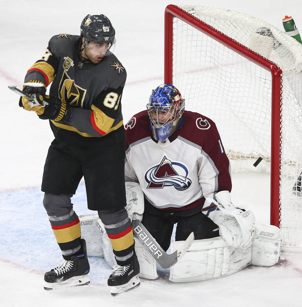 Colorado Avalanche goaltender Semyon Varlamov (1) gets scored on by Golden Knights center Jonathan Marchessault, not pictured, as Golden Knights right wing Alex Tuch (89) looks on  during the seco ...
